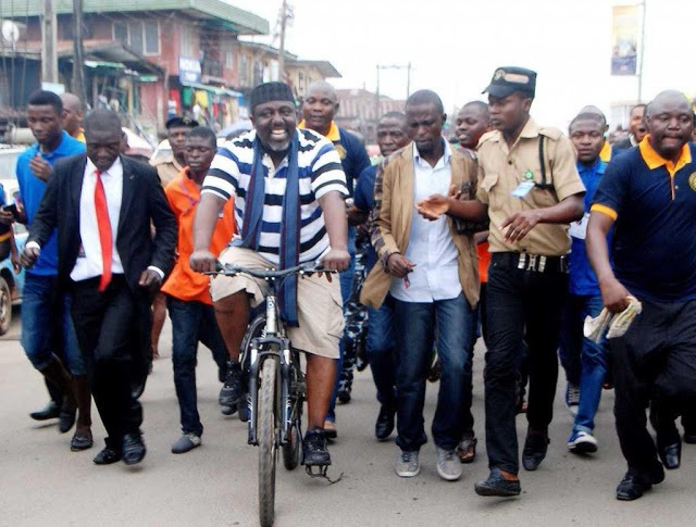 NEW TREND!!! Gov Rochas abandons convoy, rides bicycle on streets of Owerri