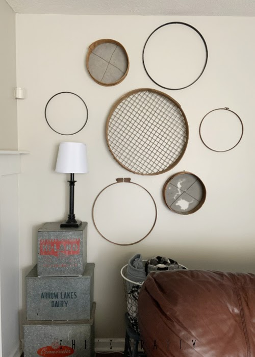 Spring Home Tour - living room gallery wall with grain sifters and embroidery hoops.