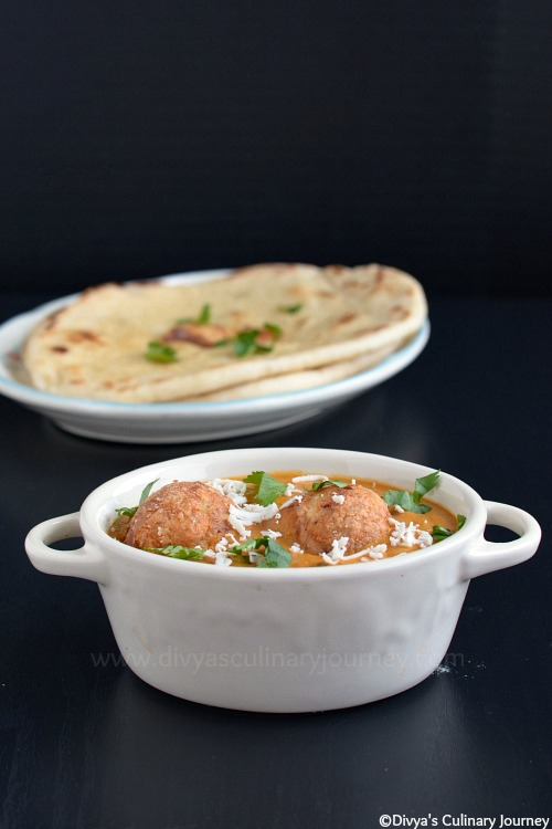 Dumplings made with paneer and potato simmered in spicy creamy tomato based gravy