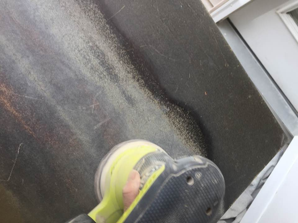 The deepest gouges were sanded smooth with an orbital sander.