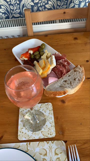 Nonna's Antipasti platter for 2 with a glass of rose wine