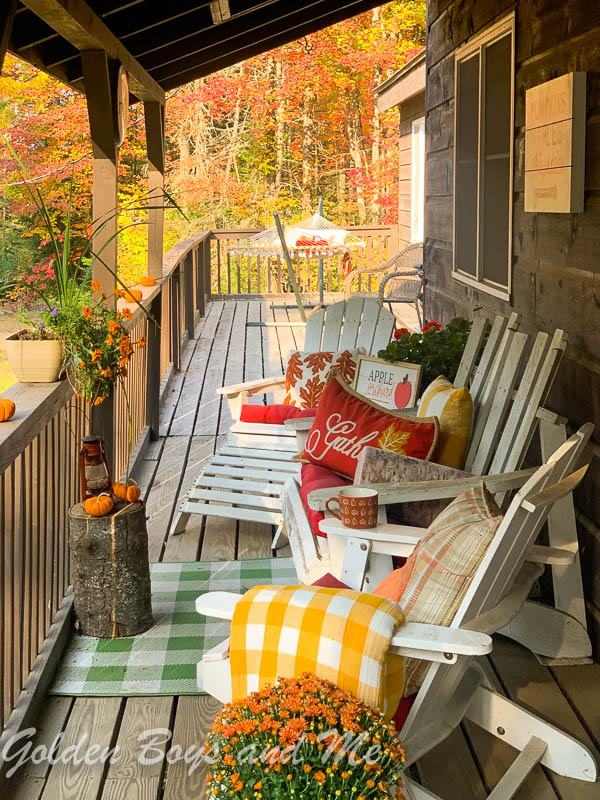 Fall foliage with autumn decor on front porch of rustic mountain cabin - www.goldenboysandme.com