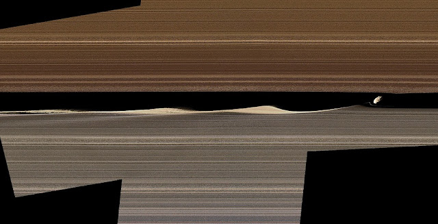 A false-color image mosaic shows Daphnis, one of Saturn's ring-embedded moons, and the waves it kicks up in the Keeler gap. Images collected by Cassini's close orbits in 2017 are offering new insight into the complex workings of the rings. Credit: NASA/JPL-Caltech/Space Science Institute