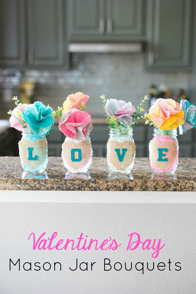 These mason jars filled with doily flowers are a pretty DIY Valentine's Day decoration or centerpiece! #valentinecrafts #valentinescrafts #masonjarcrafts #doilycrafts #doilyflowers #paperflowers #valentinesdaycrafts