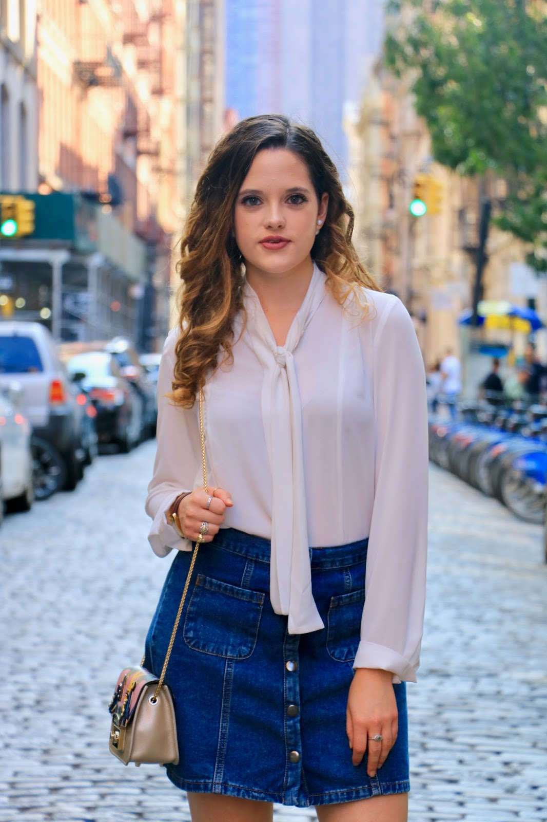Fashion blogger Kathleen Harper showing how to wear a bow blouse
