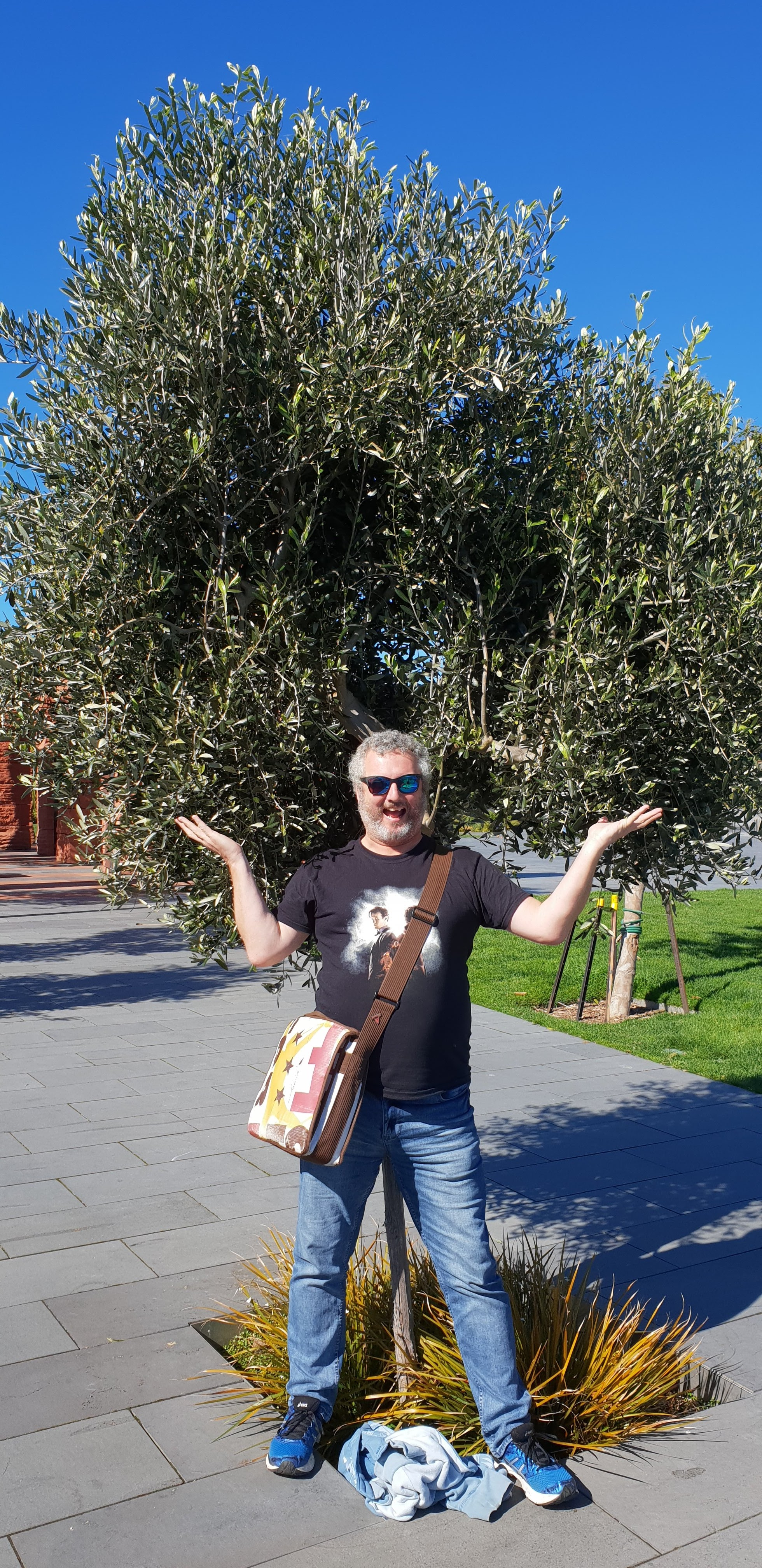 Mike happy to be stood in front of a tree