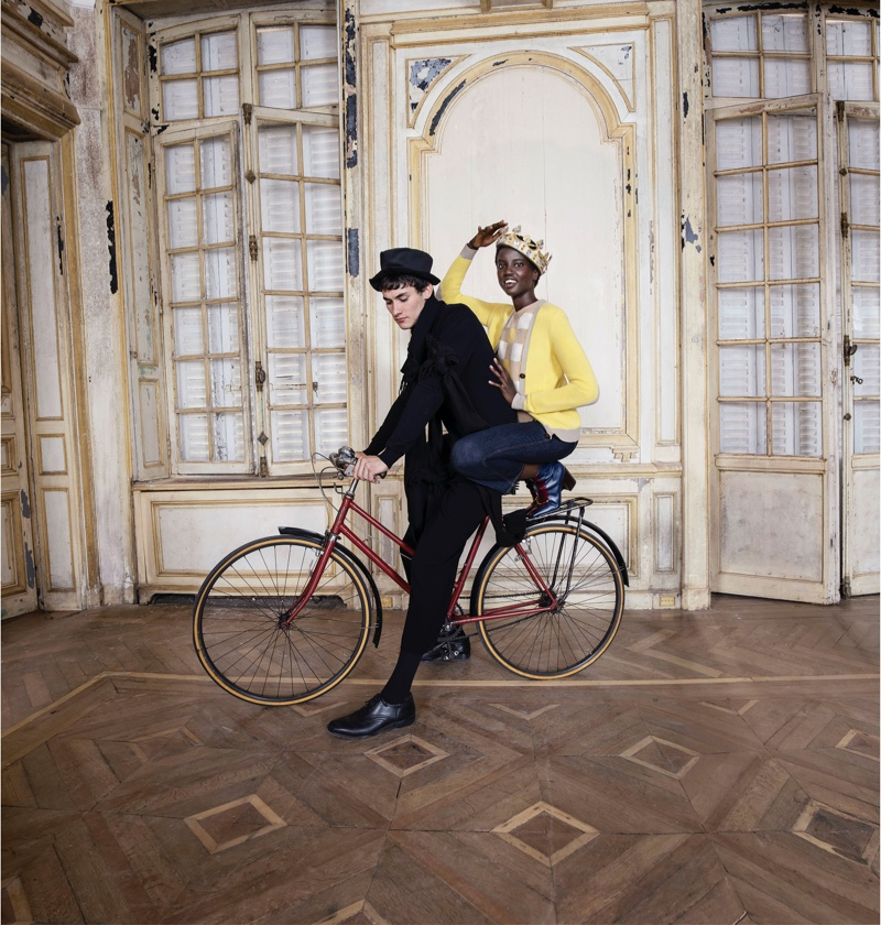 Posing on a bicycle, Anok Yai fronts Tory Burch Holiday 2020 campaign.