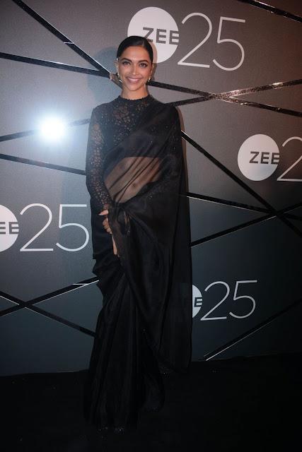 Deepika Padukone wearing a black saree