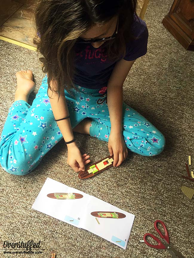 Sophia building the boat from her Moana LEGO set.
