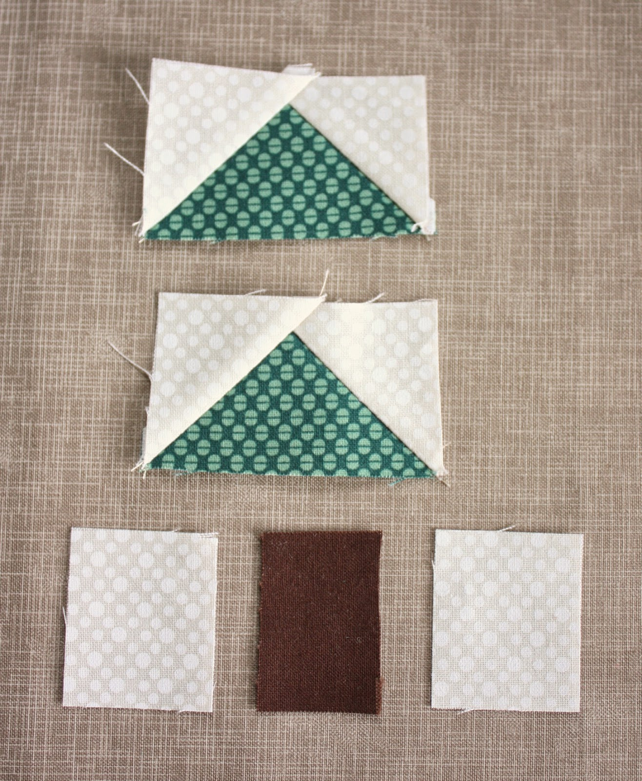 Folded fabric christmas ornaments patterns - Trim Corner 1 4 Away From Seam Fold White Triangle Open And Press Seam Toward The Triangle Repeat With Second Set Of White Squares And Green Triangle