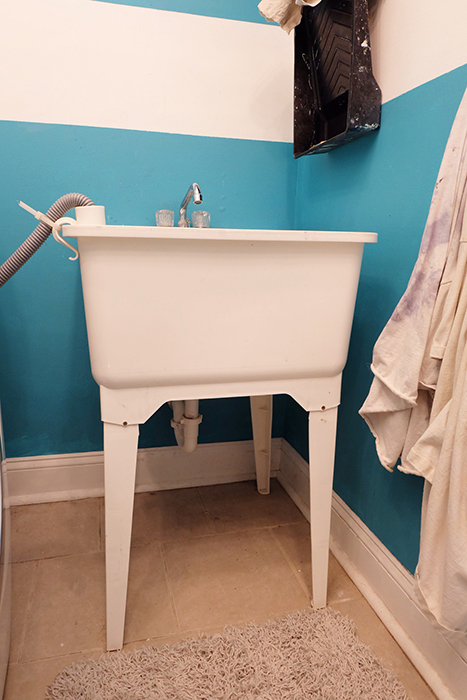 white plastic laundry utility tub sink before