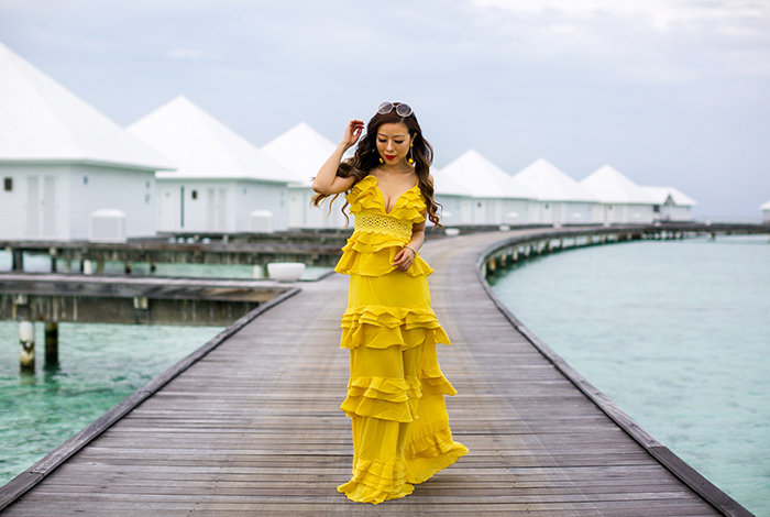 yellow tiered ruffle dress, ruffle dress, jeffrey campbell wedge sandals, baublebar earrings, maldives outfit, maldives travel, chloe sunglasses