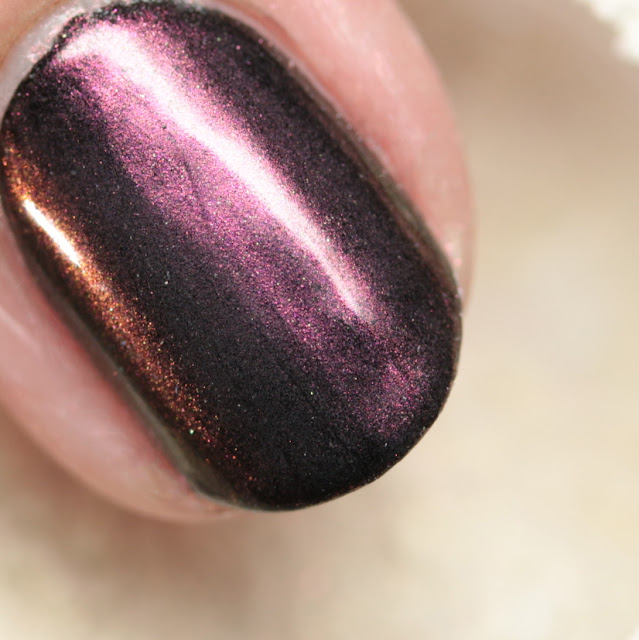 Girly Bits SFX Duo-Chrome Powder Zephyr over black polish