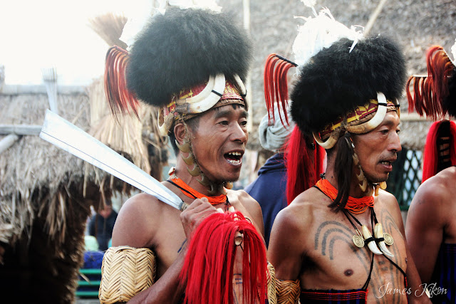 Khiamniungan Naga tribesmen perform traditional folk song and dance