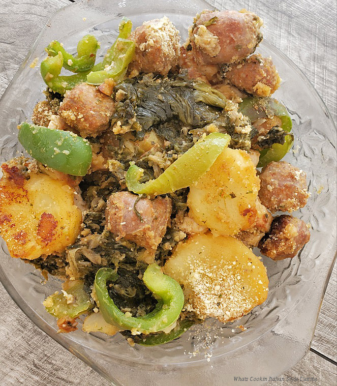 this is a bowl of escarole with potatoes, peppers and bread crumbs on top