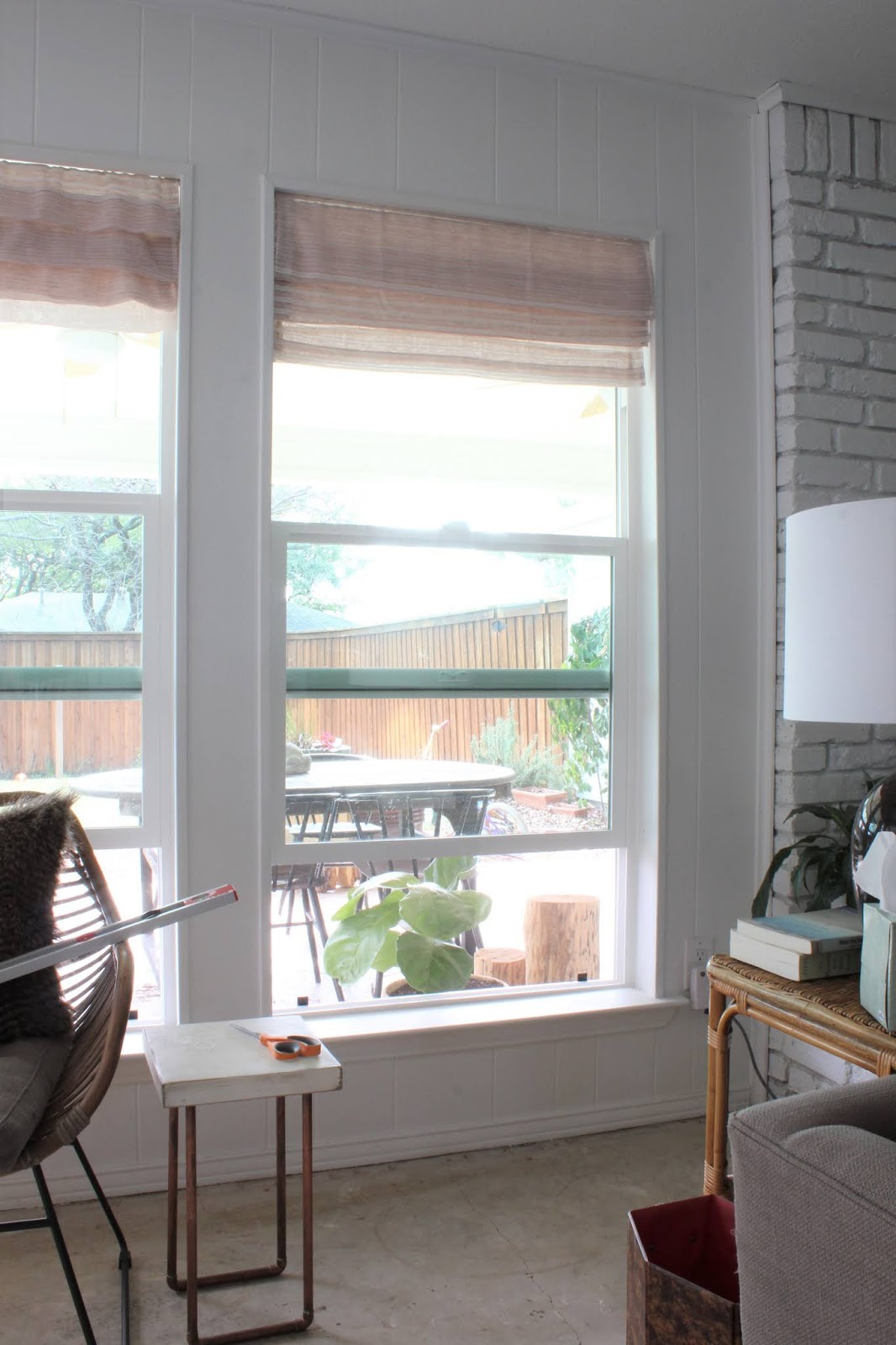 We needed a little color and texture on the windows in our living room. We didn't need the privacy so I didn't want to pay for actual shades. Instead I made two faux roman shades for under $40 and I love them! | House Homemade