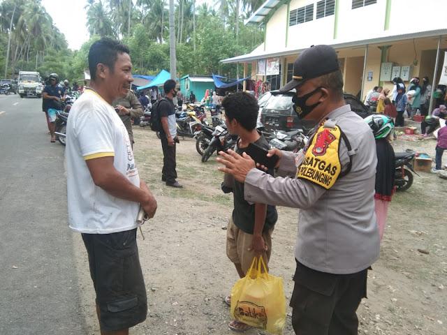 Kapolsek Bontomamai : 15  Pelanggar Prokes Terjaring Operasi Yustisi di Pasar Barugaia