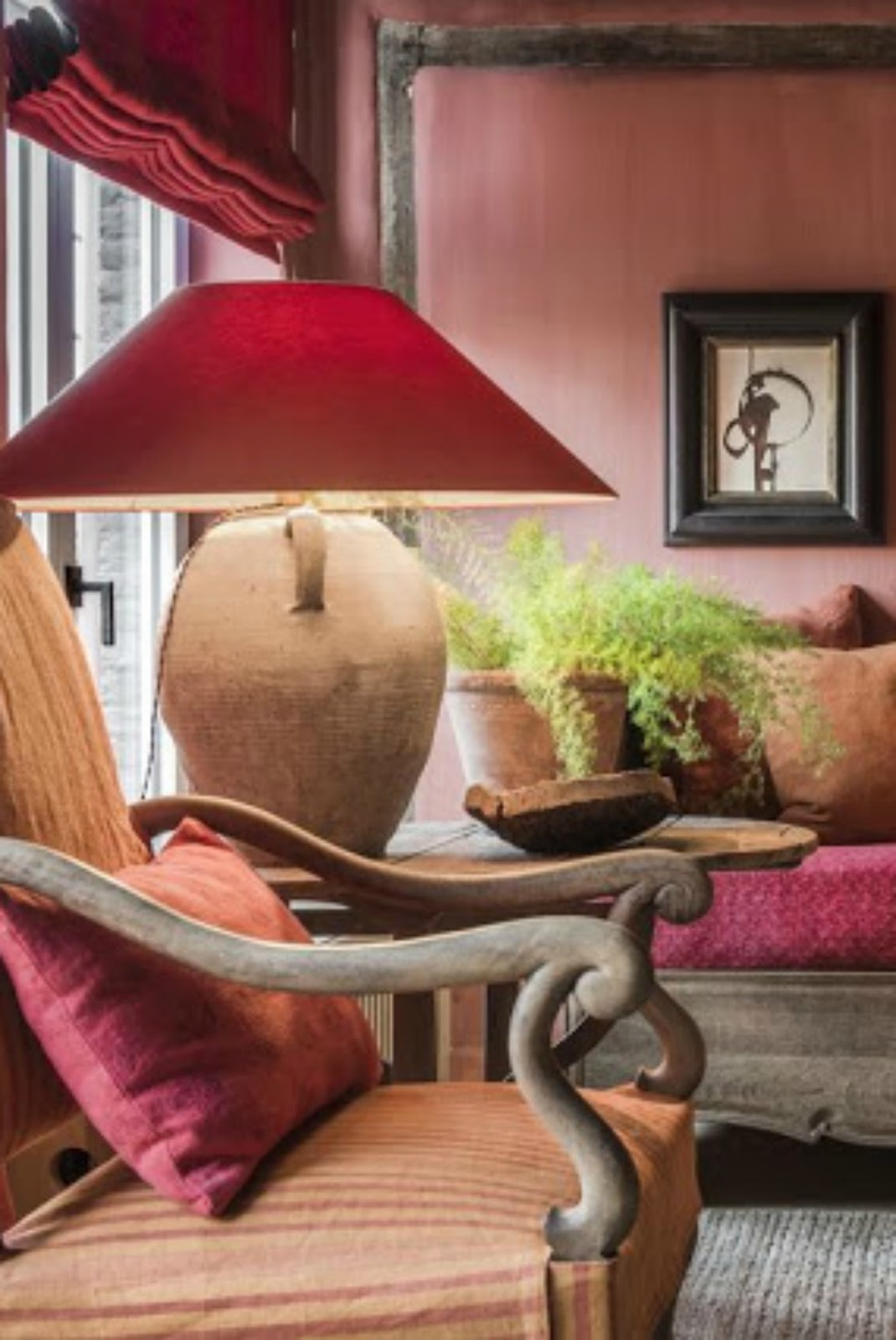 Bold color in the Belgian style interior design of a a living room - found on Hello Lovely Studio