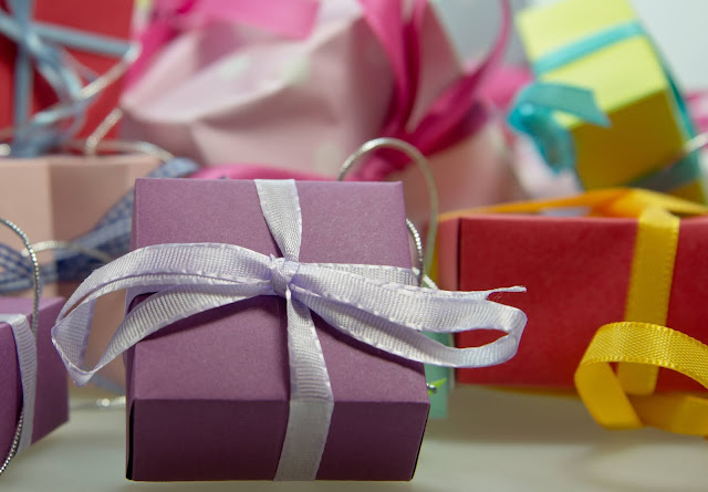 Brightly colored gift boxes and ribbons.
