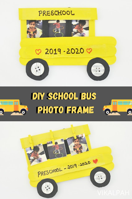 DIY school bus photo frame using popsicle sticks on a white background