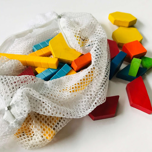 Use a mesh bag to clean math manipulatives.  It will keep them together when you wash and you have to scoop by the handful from the sink when washing.