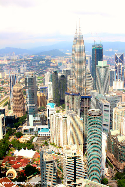 View of Petronas Towers from KL Tower Observation Deck, Kuala Lumpur. Best tourist attraction in KL. Things to do in KL tower