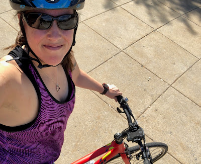 Selfie of Jean in a bike helmet. You can see part of the bike she is sitting on.
