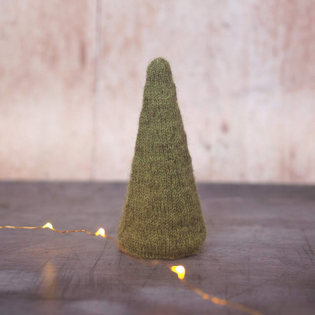 Solid green conical tree