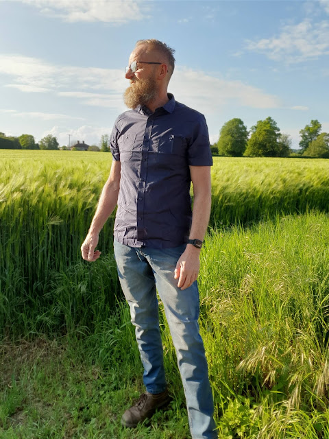 Man modelling military style navy short sleeved shirt from Jacamo
