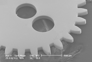 SEM images of a micro nickel gear<br />electroformed on a KMPR mould. The KMPR is<br />completely removed after demoulding - Univerity of Birmingham