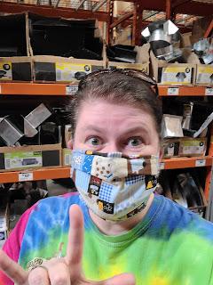 Nancy in Home Depot, wearing a mask