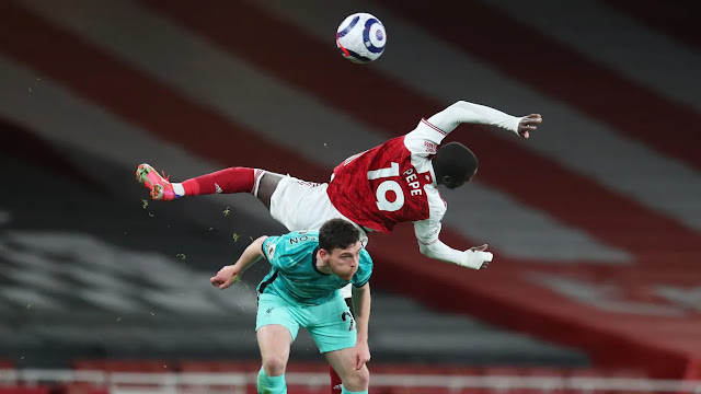Liverpool defender Robertson challenges Arsenal winger Pepe