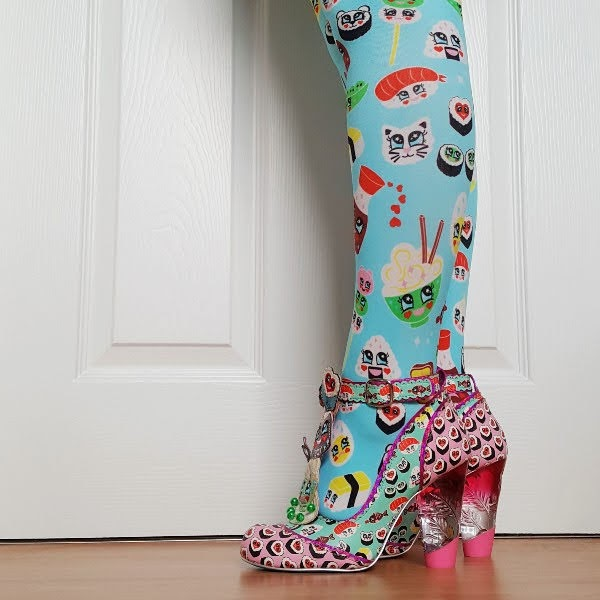 legs wearing colourful tights and sushi themed shoes with lucite heel
