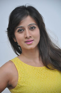 Actress Harshika Poonacha Stills in Yellow Short Dress at Appudala Ippudila Movie Promotions  0002