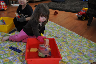 fine motor play by hammering blocks of ice