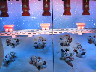 The Bay Christmas Windows 2019 Snowmen make Snow angels.