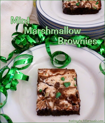Mint Marshmallow Brownies are thick, rich mint flavored brownies baked with a mint marshmallow topping | Recipe developed by www.BakingInATornado.com | #dessert #chocolate