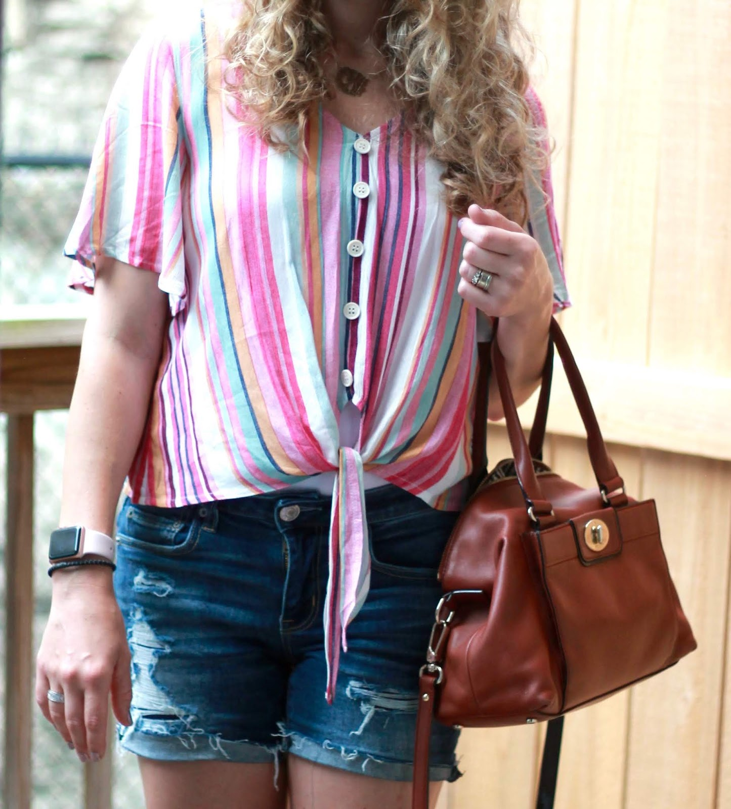 striped tie front top, distressed denim shorts, straw fedora hat, cognac crossbody, ABEO blush wedges,