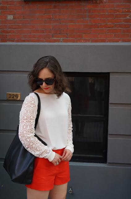 Orange linen shorts, lace blouse