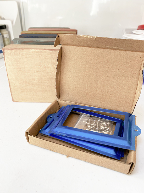 metal label holders in a box