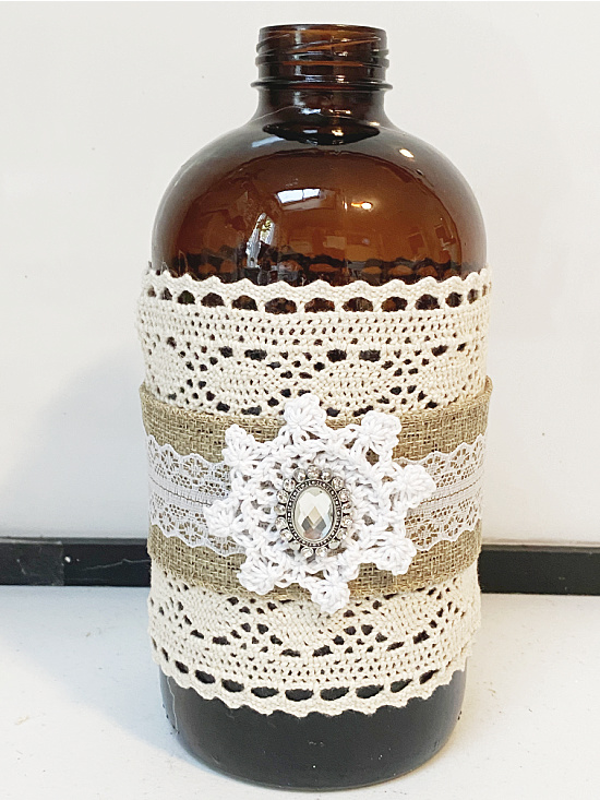 Amber bottle wrapped with lace and bling