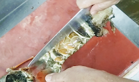 Cutting lobster tail for removing lobster tails meat
