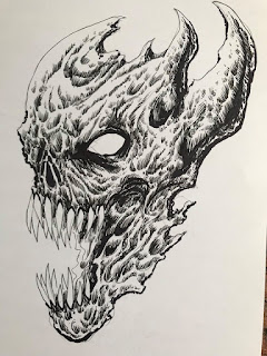 inking a demons head step by step process