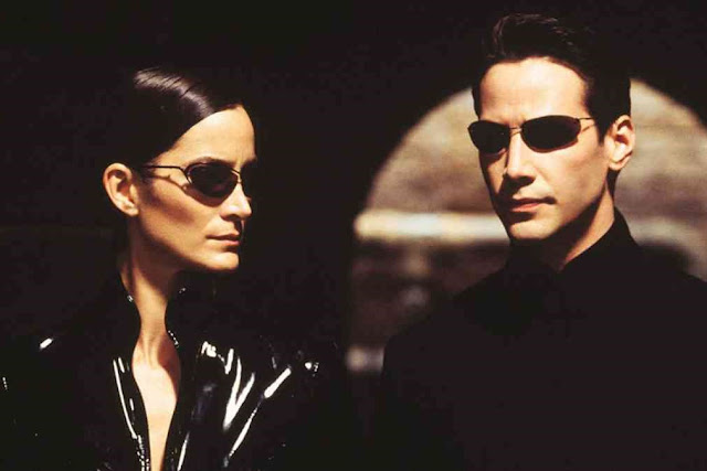 Keanu Reeves e Carrie-Anne Moss