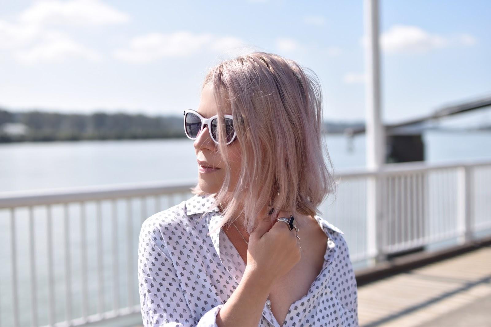 Monika Faulkner outfit inspiration - white patterned shirt, white sunglasses