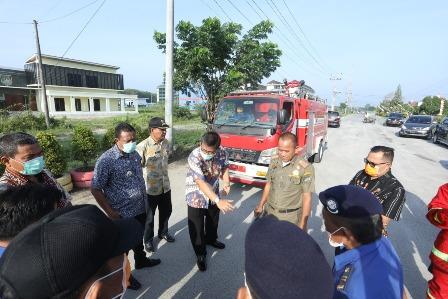 Asisten Perekonomian dan Pembangunan lakukan penyemprotan Disinfektan  Kota Kisaran.