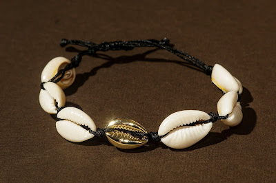 Seashell bracelet on knotted black cord with gold shell