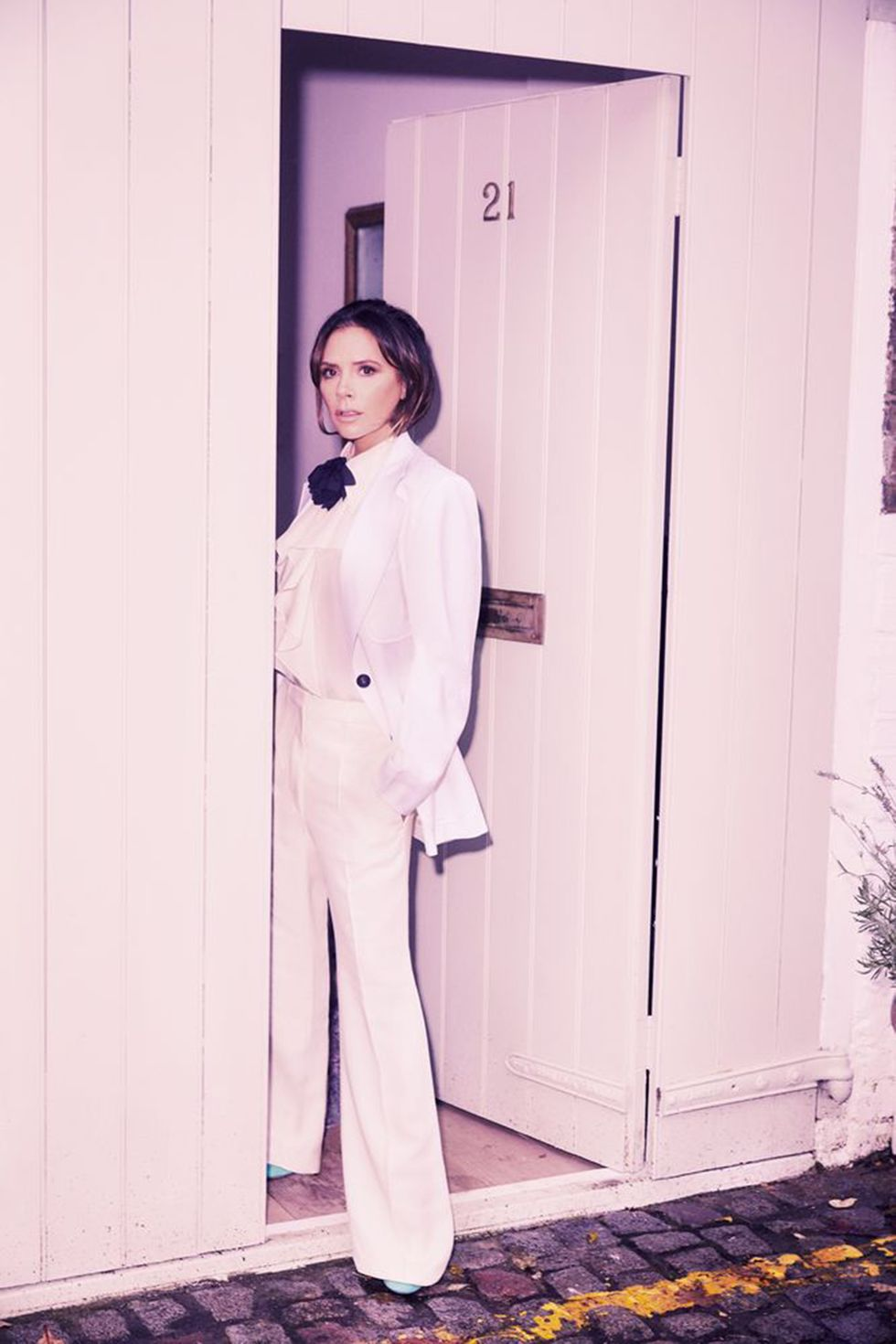 Jacket, ruffle-neck shirt, trousers and suede heels all Victoria Beckham