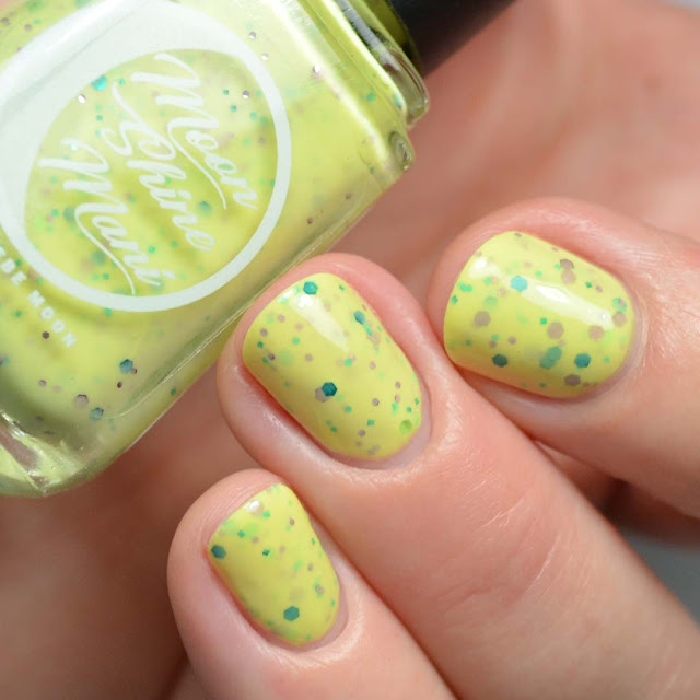 yellow nail polish with purple and green glitter