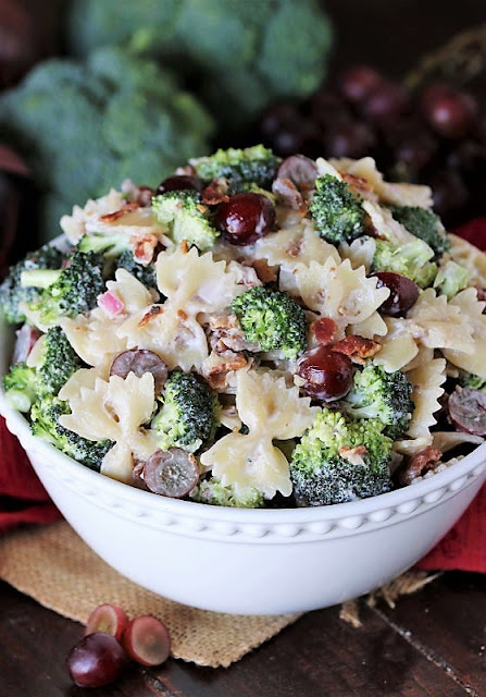 Serving Bowl of Broccoli Pasta Salad with Grapes Image